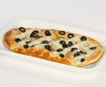 Italian bread with mozzarella, olives and oregano