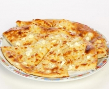 Pita bread with yellow cheese and cheese